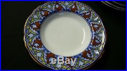64-piece Cottura pottery set with Blue, Red & Yellow Floral Pattern, Italy